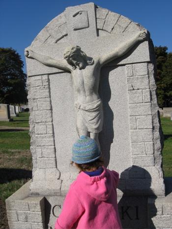 Bella before Crucifix tombstone